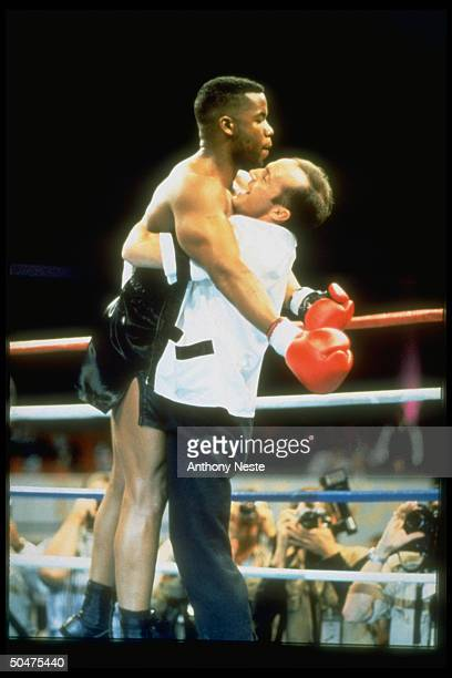 Actor Michael Jai White, as boxer Mike Tyson, being hugged by trainer, actor Clark Gregg, after scoring knockout in scene fr. HBO movie Tyson.