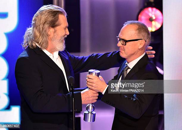 Actor Michael Keaton accepts Movie Performance of the Year Actor from actor Jeff Bridges onstage during the PEOPLE Magazine Awards at The Beverly...