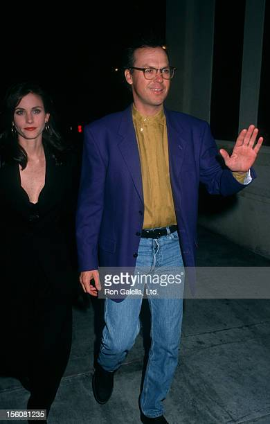 Actor Michael Keaton and actress Courteney Cox attending the wrap party for 'Batman Returns' on March 6 1992 at the Mayan Theater in Los Angeles...