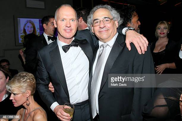 Actor Michael Keaton and Fox Searchlight CoPresident Steve Gilula attend The 72nd Annual Golden Globe Awards at The Beverly Hilton on January 11 2015...