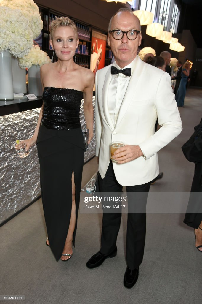 Actor Michael Keaton (R) attends the 2017 Vanity Fair Oscar Party hosted by Graydon Carter at Wallis Annenberg Center for the Performing Arts on February 26, 2017 in Beverly Hills, California.
