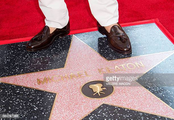 Actor Michael Keaton poses for photographers during a ceremony honouring him with a star on Hollywood Walk of Fame in Hollywood California on July 28...