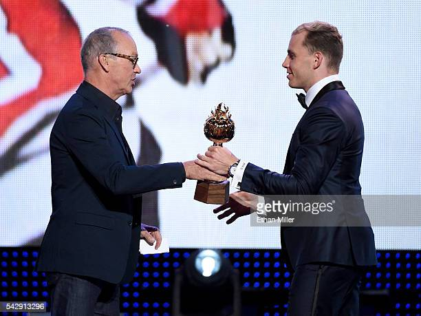 Actor Michael Keaton presents the Hart Trophy to Patrick Kane of the Chicago Blackhawks during the 2016 NHL Awards at The Joint inside the Hard Rock...