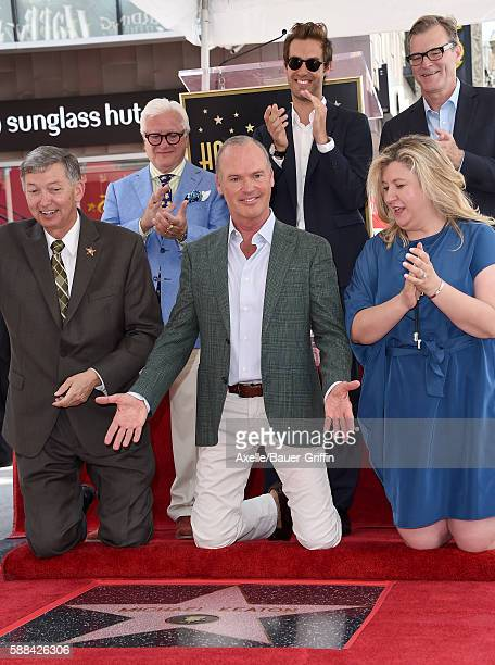 Actor Michael Keaton songwriter Sean Douglas screenwiter John Lee Hancock and CEO of the Hollywood Chamber of Commerce Leron Gubler attend the...