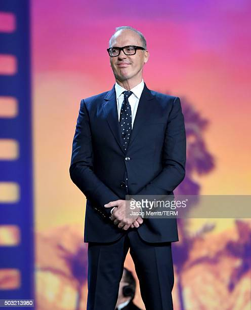 Actor Michael Keaton speaks onstage at the 27th Annual Palm Springs International Film Festival Awards Gala at Palm Springs Convention Center on...