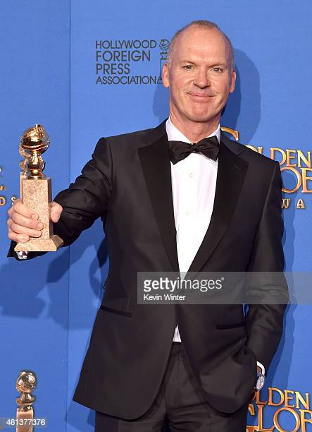 Actor Michael Keaton, winner of Best Actor in a Motion Picture - Musical or Comedy for 'Birdman,' poses in the press room during the 72nd Annual...