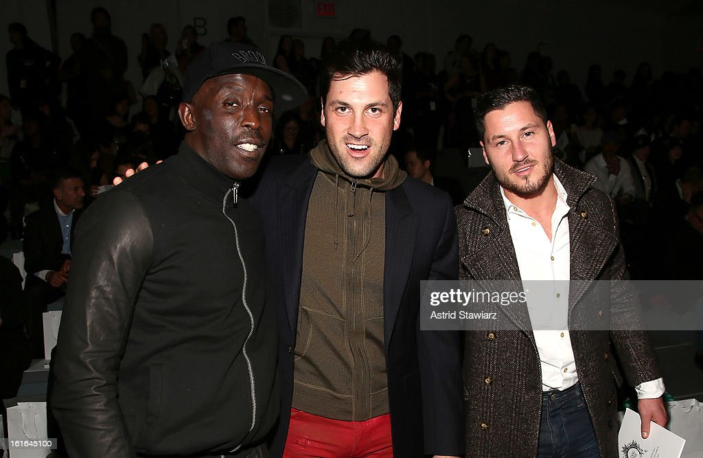 Actor Michael Kenneth Williams and dancers Maksim Chmerkovkskiy and Valentin Chmerkovskiy attend the Zang Toi Fall 2013 fashion show during Mercedes-Benz Fashion Week at The Stage at Lincoln Center on February 13, 2013 in New York City.