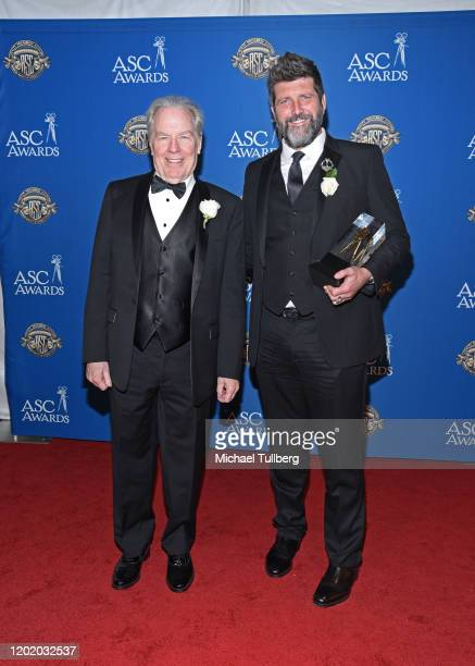 Actor Michael McKean and cinematographer John Conroy with Conroy's award for Motion Picture, Miniseries or Pilot Made for Television at the 34th...