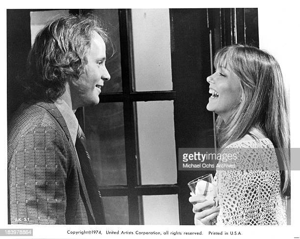 Actor Michael Moriarty and actress Susan Blakely on set of the United Artists movie Report to the Commissioner in 1975