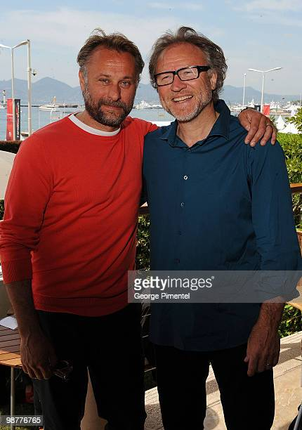 Actor Michael Nyqvist and producer Soren Staermose pose during the 'The Girl With the Dragon Tattoo' photo call at the Scandinavian Terrace during...