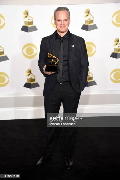 Actor Michael Park winner of the Best Musical Theater Album award for 'Dear Evan Hansen' poses in the press room during the 60th Annual GRAMMY Awards...