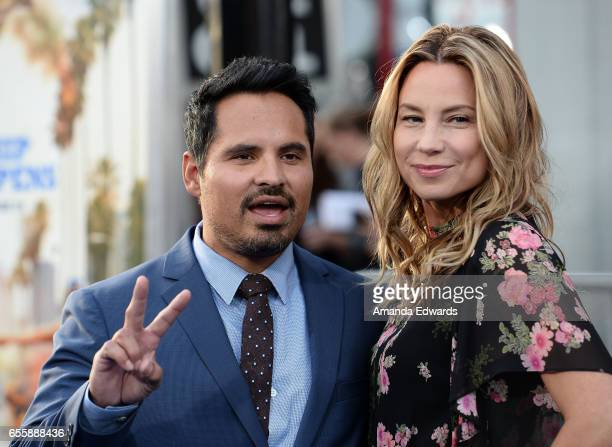 Actor Michael Pena and Brie Shaffer arrive at the premiere of Warner Bros Pictures' CHiPS at the TCL Chinese Theatre on March 20 2017 in Hollywood...