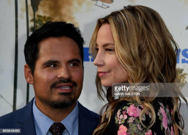 Actor Michael Pena and screenwriter Brie Shaffer arrive for the film premiere of 'CHiPS' at the TCL Chinese Theatre in Hollywood California on March...