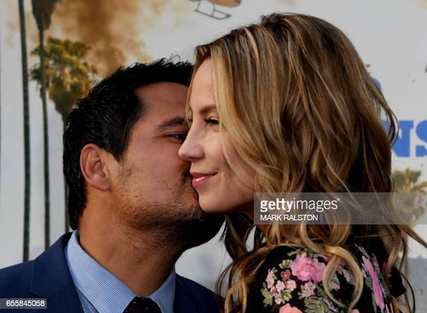 Actor Michael Pena and screenwriter Brie Shaffer arrive for the premiere of CHiPS' at the TCL Chinese Theatre in Hollywood California on March 20...