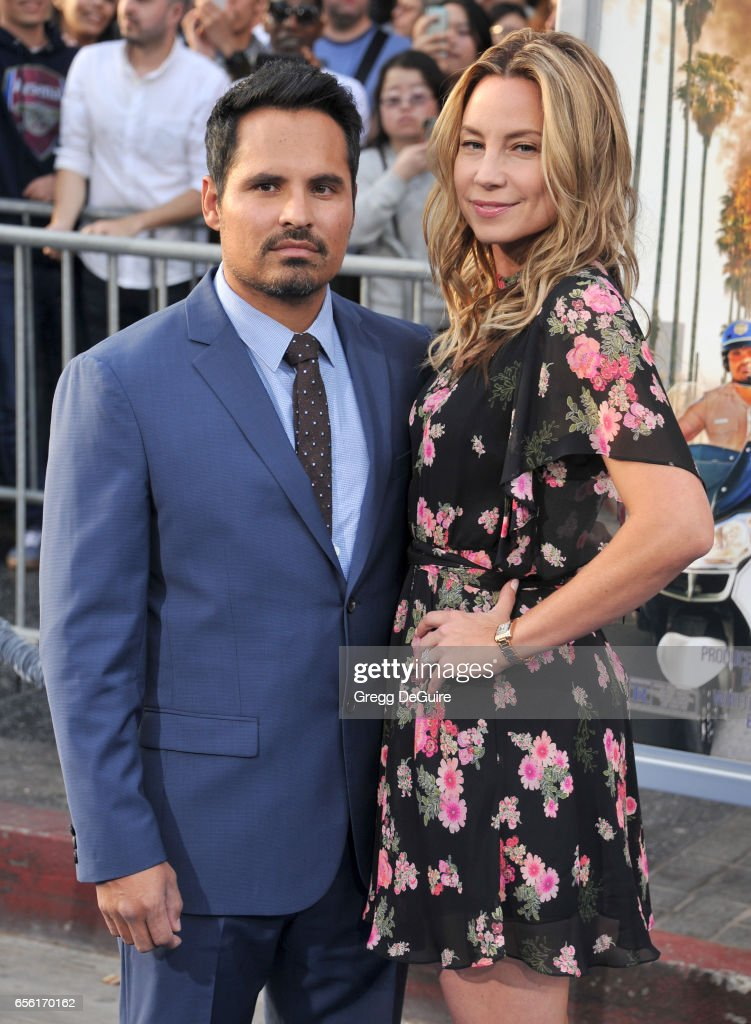 Actor Michael Pena and wife Brie Shaffer arrive at the premiere of Warner Bros. Pictures' 'CHiPS' at TCL Chinese Theatre on March 20, 2017 in Hollywood, California.