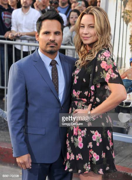 Actor Michael Pena and wife Brie Shaffer arrive at the premiere of Warner Bros Pictures' CHiPS at TCL Chinese Theatre on March 20 2017 in Hollywood...