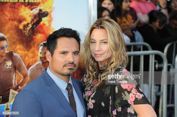 Actor Michael Pena and wife Brie Shaffer attend the premiere of Warner Bros Pictures' CHiPS at TCL Chinese Theatre on March 20 2017 in Hollywood...