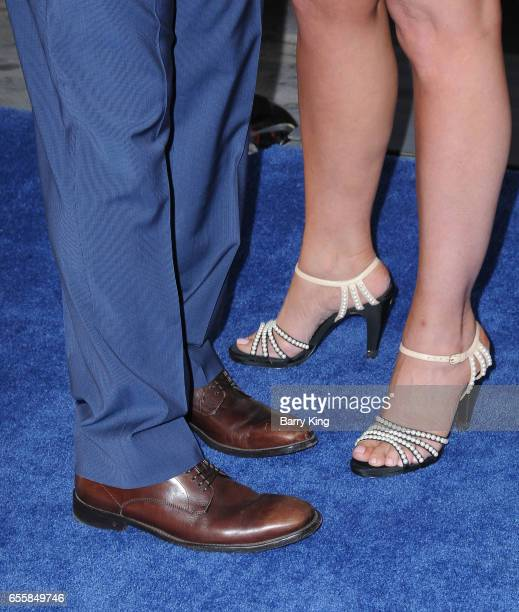 Actor Michael Pena and wife Brie Shaffer shoe detail arrive at the premiere of Warner Bros Pictures' 'CHiPS' at TCL Chinese Theatre on March 20 2017...