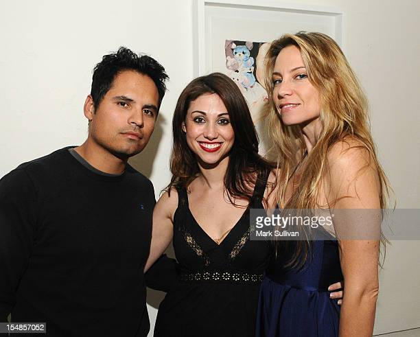 Actor Michael Pena artist Diane MarshallGreen and writer Brie Schaffer during the opening reception for Diane MarshallGreen's Lolitas at America...