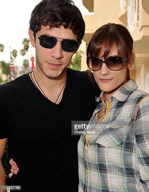 Actor Michael Rady in Giorgio Armani 749s sunglasses and actress Rachael Kemery in Giorgio Armani 756s sunglasses pose at the Solstice Sunglass...