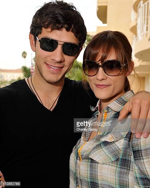 Actor Michael Rady in Giorgio Armani 749s sunglasses and fiance Rachael Kemery in Giorgio Armani 756s sunglasses pose at the Solstice Sunglass...