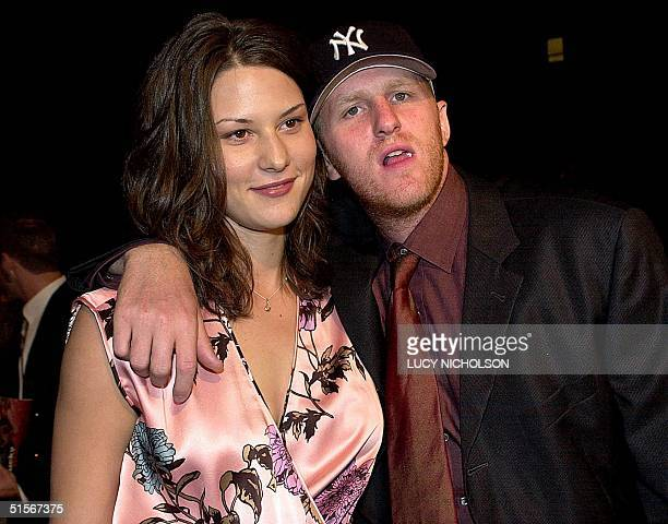 US actor Michael Rapaport arrives at the premiere of his new film Lucky Numbers with his wife Nichole Beattie in Hollywood 24 October 2000 AFP...