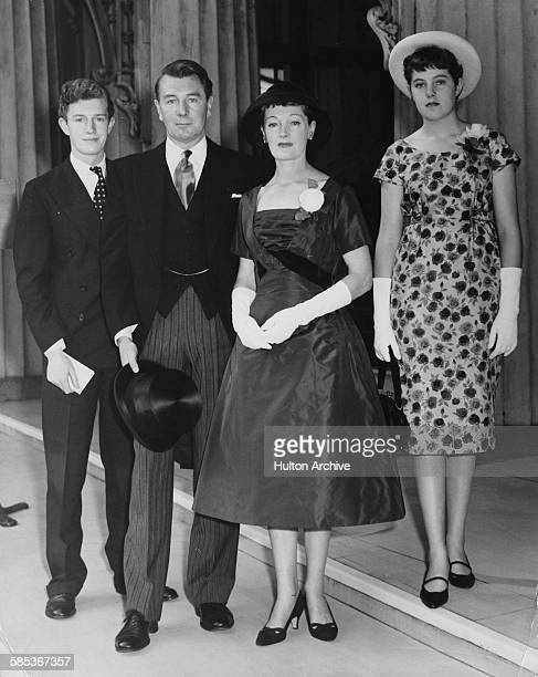 Actor Michael Redgrave pictured with his wife Rachel Kempson and children Corin and Lynn at Buckingham Palace to receive his investiture London July...