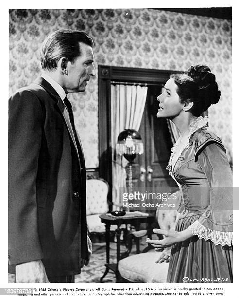 Actor Michael Rennie and actress Kathryn Hays on set of the Columbia Picture movie Ride Beyond Vengeance in 1966