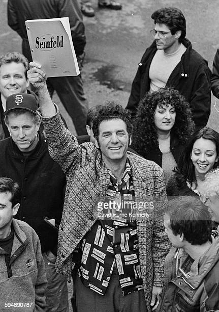 Actor Michael Richards who plays 'Kramer' holds a script of the final episode in the air amongst a sea of cast and crew members from the hit...