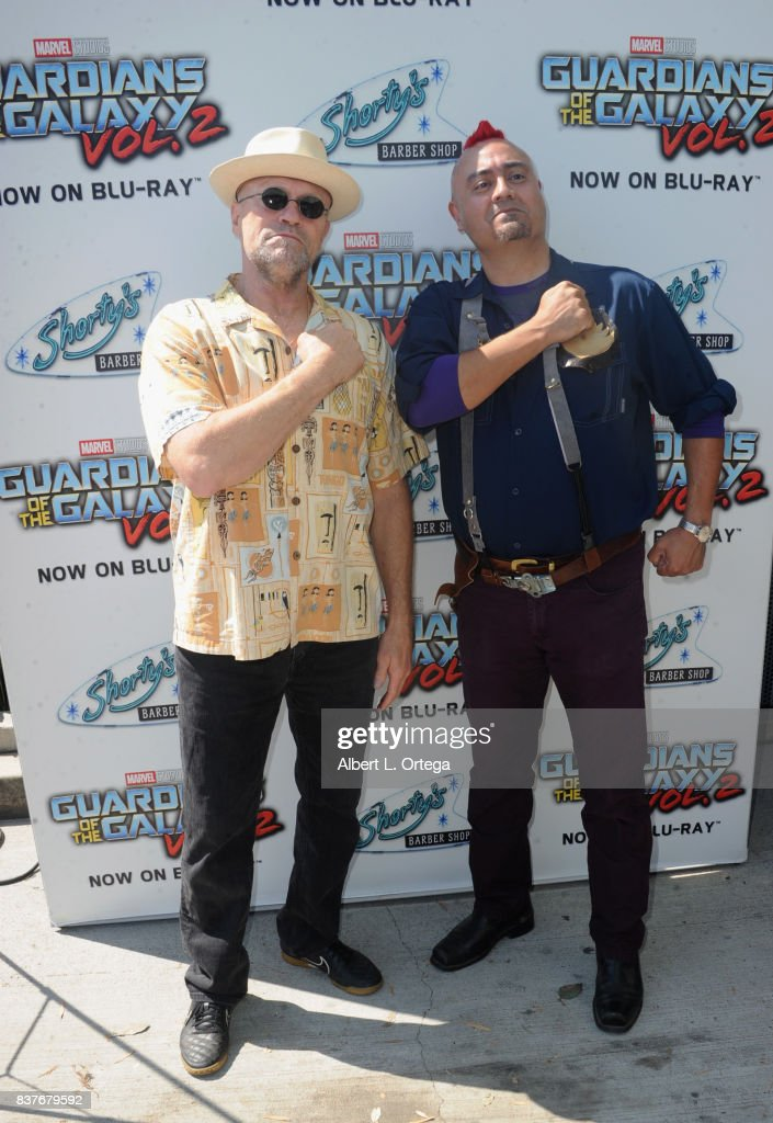 Actor Michael Rooker poses with fans with Yondu mohawks at Disney's Celebration for the Release Of 'Guardians Of The Galaxy Vol. 2' Blu-ray held at Shorty's Barber Shop on August 22, 2017 in West Hollywood, California.