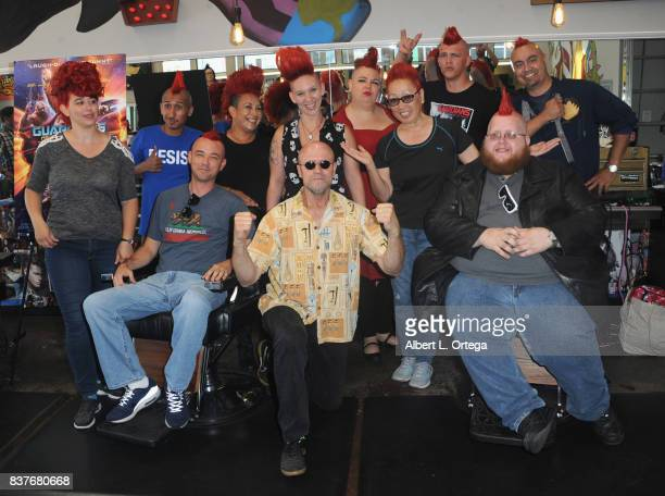 Actor Michael Rooker poses with fans with Yondu mohawks at Disney's Celebration for the Release Of 'Guardians Of The Galaxy Vol 2' Bluray held at...