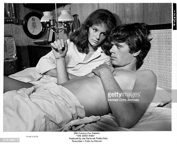 Actor Michael Sarrazin and Jacqueline Bisset talk in bed in a scene of the 20th Century Fox movie 'The Sweet Ride' circa 1968