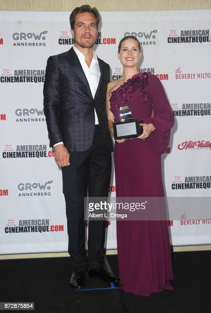 Actor Michael Shannon presents to actress Amy Adams at the 31st Annual American Cinematheque Awards Gala Photo Op held at The Beverly Hilton Hotel on...