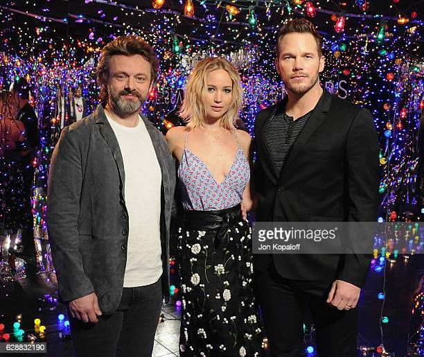 """Actor Michael Sheen, actress Jennifer Lawrence and actor Chris Pratt pose at the photo call for Columbia Pictures' """"Passengers"""" at the Four Seasons..."""