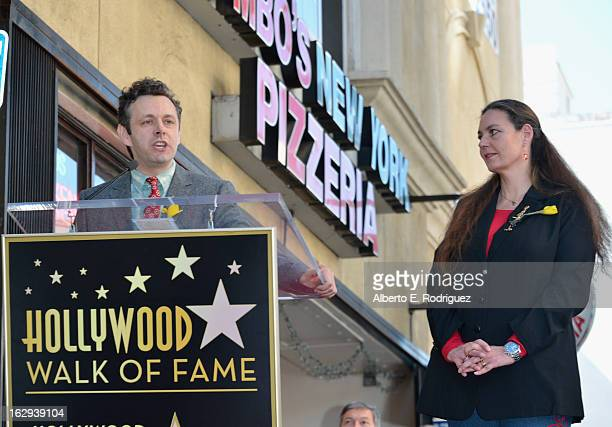 Actor Michael Sheen and Richard Burton's daughter Maria Burton attends a ceremony honoring Richard Burton with the 2,491st star on the Hollywood Walk...