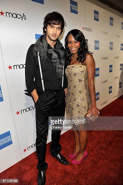 Actor Michael Steger and wife arrive at the Macy's Passport gala held at Barker Hangar on September 24 2009 in Santa Monica California