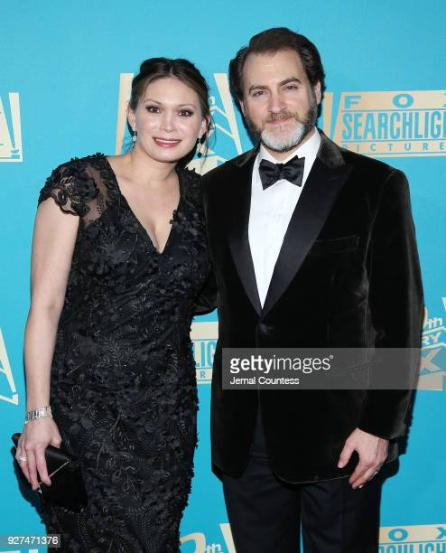 Actor Michael Stuhlbarg and MaiLinh Lofgren attend the Fox Searchlight And 20th Century Fox Oscars PostParty on March 4 2018 in Los Angeles California