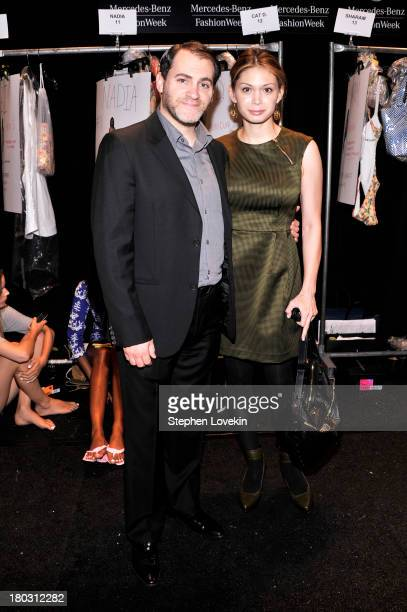 Actor Michael Stuhlbarg and MaiLinh Lofgren pose backstage at the Nanette Lepore fashion show during MercedesBenz Fashion Week Spring 2014 at The...