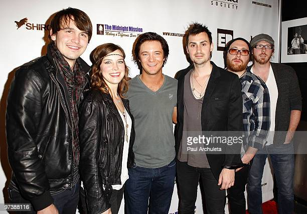 Actor Michael Welch poses with Jason Bynum Pap Shirock Chuck Shirock Derek Blank and Adam Gatchel of Rock band Shirock as they arrive at the...