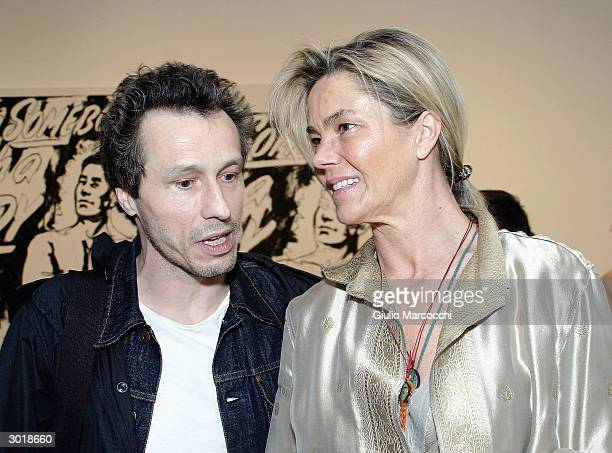 Actor Michael Wincott and Nadine Johnson attend the opening reception of Andy Warhol and Helmut Newton's work February 26 2004 at Gagosian Gallery in...