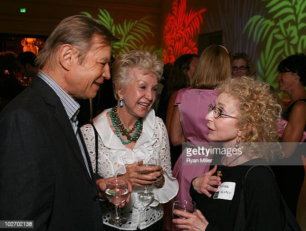 Actor Michael York and artist Pat York talk with Nasher Sculpture Center Founder Andrea Nasher during the Mingle With The Mammals VIP reception to...