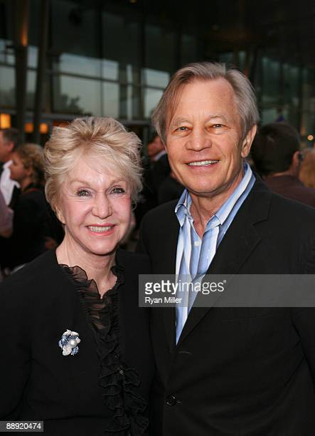 Actor Michael York and wife Patricia McCallum pose during the arrivals for the opening night performance of Monty Python's Spamalot at the Center...