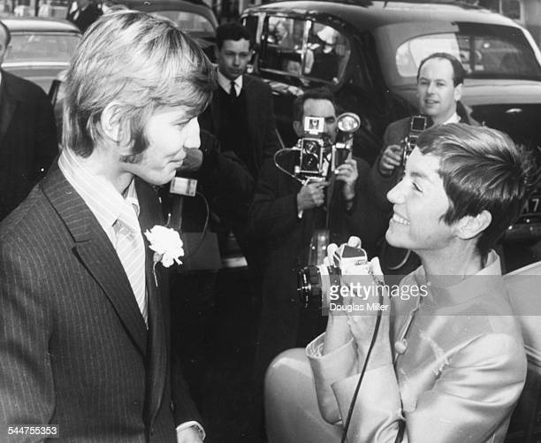 Actor Michael York having his picture taken by photographer Patricia McCallum following their wedding at Kensington Registry Office London March 27th...