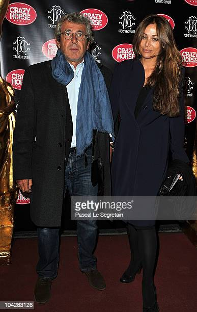 Actor Michel Boujenah poses with his wife during a photo call at Le Crazy Horse on September 19 2010 in Paris France