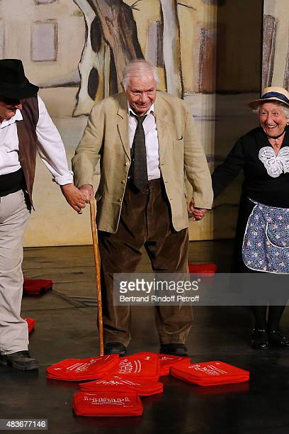 Actor Michel Galabru acknowledges the applause of the audience whyle the traditional throw of cushions at the final of the 'Jofroi' Theater Play...