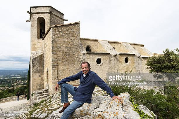 Actor Michel Leeb is photographed for Le Figaro Magazine on June 15 2016 in the renovated church of Oppede le Vieux in Oppede France PUBLISHED IMAGE...