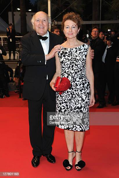 Actor Michel Piccoli and Ludivine Clerc leave after the Habemus Papam Premiere during the 64th Annual Cannes Film Festival at the Palais des...