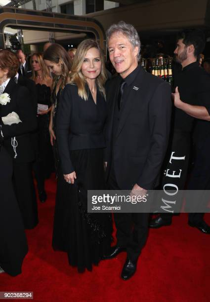 Actor Michelle Pfeiffer and writer/producer David E Kelley celebrate The 75th Annual Golden Globe Awards with Moet Chandon at The Beverly Hilton...