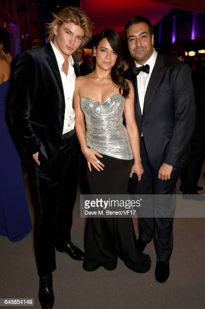 Actor Michelle Rodriguez producer Mohammed Al Turki and Australian model Jordan Barrett attend the 2017 Vanity Fair Oscar Party hosted by Graydon...