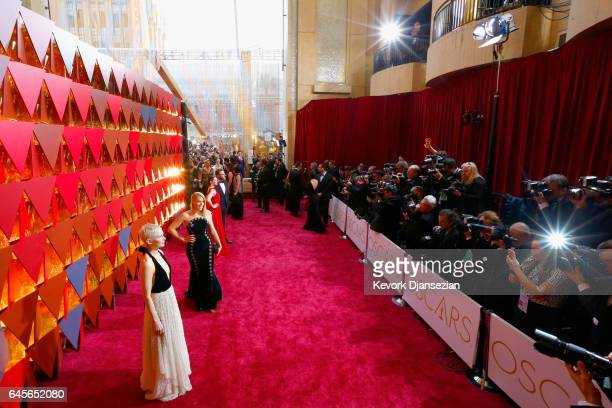 Actor Michelle Williams actor Busy Philipps Lauren Miller and actor Seth Rogen attend the 89th Annual Academy Awards at Hollywood Highland Center on...
